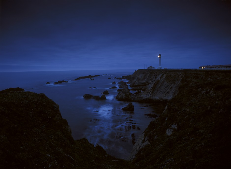 USA: California: Mendocino County: Point Arena Lighthouse and the Pacific Ocean at twilight