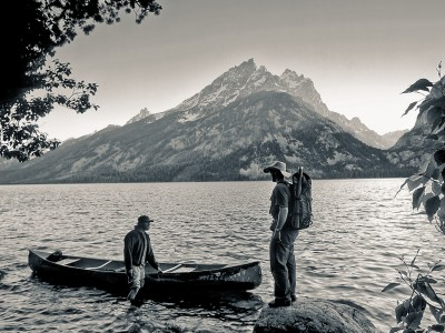 USA: Wyoming: Grand Teton National Park: Two friends head out in